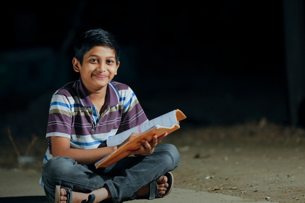 Cute indian child studying at home