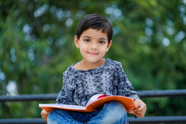Cute indian child studying