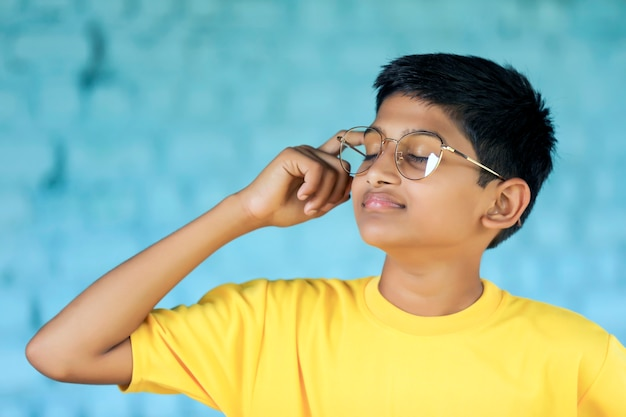 Cute indian little child wearing spectacles and giving expression.