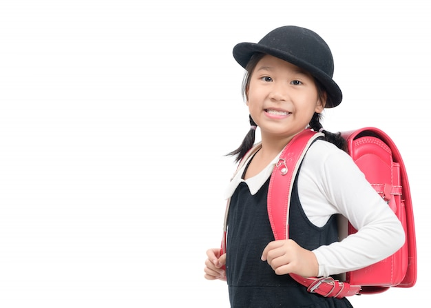 Cute japanese student with school bag isolated
