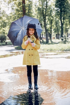 Cute kid plaiyng on a rainy day