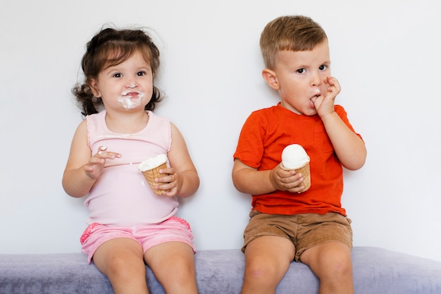 Cute kids eating ice cream