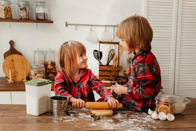 Cute kids making christmas cookies together