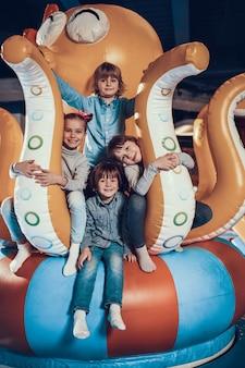 Cute kids on modern indoor playground