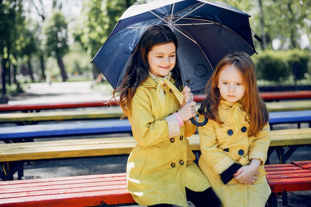 Cute kids plaiyng on a rainy day
