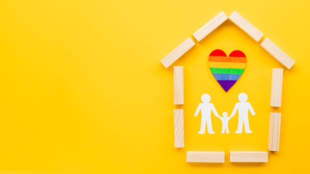 Cute lgbt family concept arrangement on yellow background with copy space