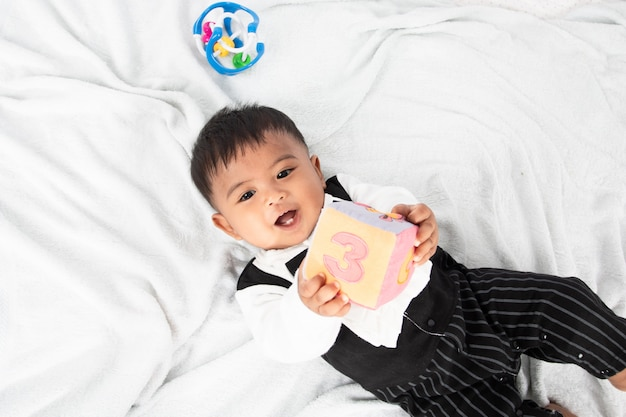 Cute little asian baby boy  play toy