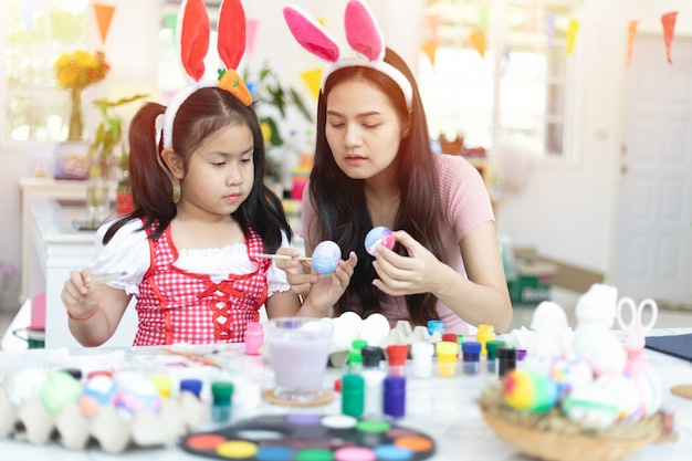 Cute little asian child girl wearing bunny ears on easter day.