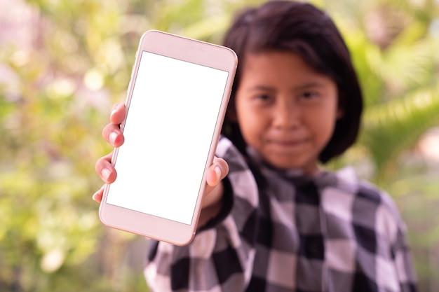 A cute little asian girl showing smartphone with white blank screen