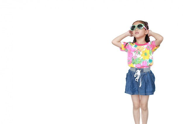 Cute little asian kid girl wearing a flowers summer dress and sunglasses isolated. ready for summer vacation.