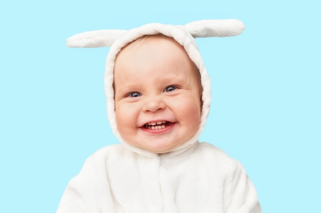 Cute little baby in bunny costume is smiling