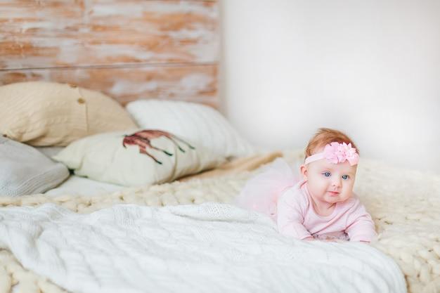 Cute little baby girl in bed