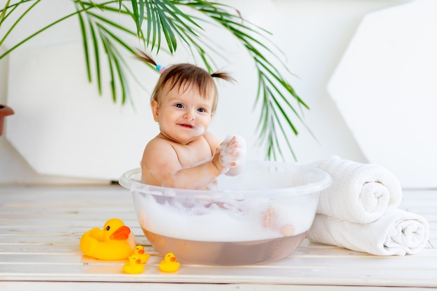 Cute little baby girl taking a bath