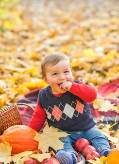 Cute little baby with pumpkin laughing