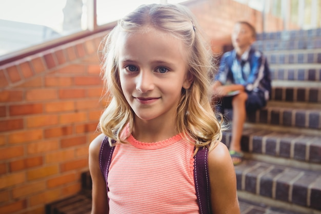 Cute little blonde girl looking at the camera