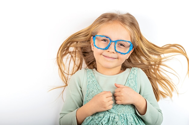 Cute little blonde girl with 3d plastic glasses