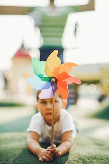 Cute little boy has fun on a playground