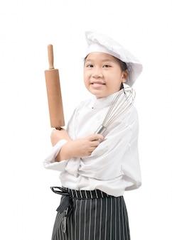 Милый маленький мальчик в костюме шеф-повара