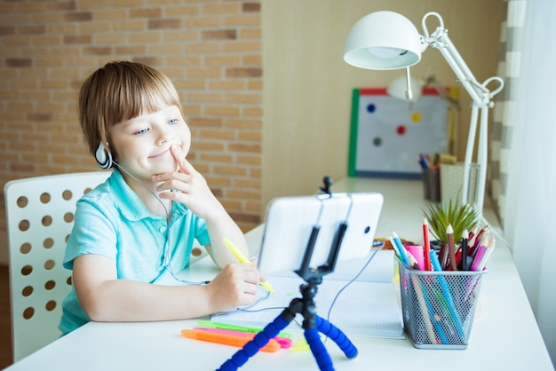 Cute little boy painting with color pencils at home, in kindergaten or preschool. creative games for kids staying at home