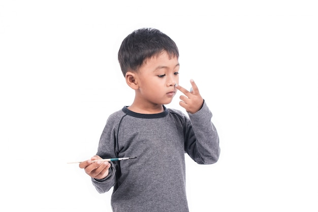 Cute little boy play painting on nose