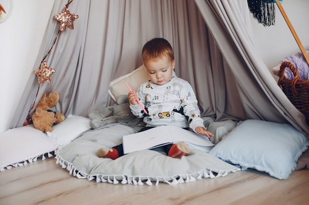Cute little boy playing at home