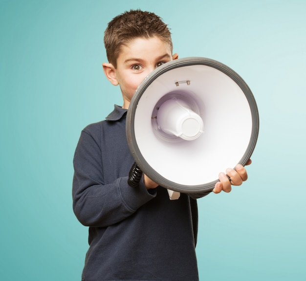 Cute little boy using a megaphone