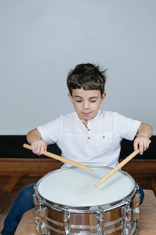 Cute little boy with drum and sticks