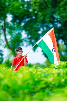 Cute little boy with indian national tricolor flag