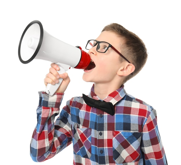 Cute little boy with megaphone on white