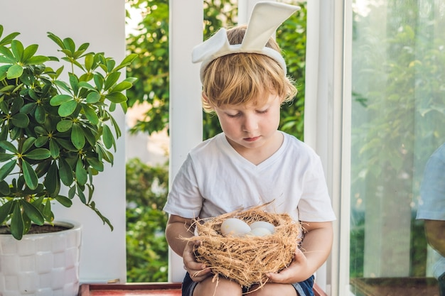 Cute little child boy wearing bunny ears on easter day