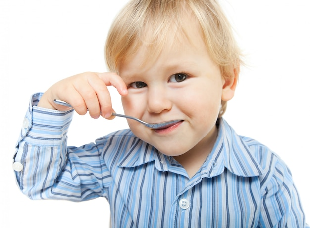 Cute little child eating