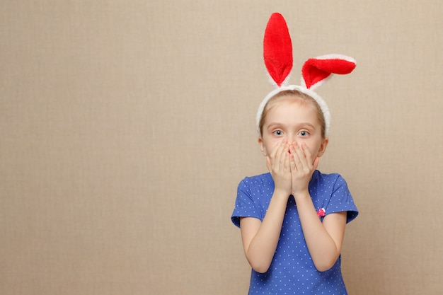 Cute little child girl wearing bunny ears on easter day.