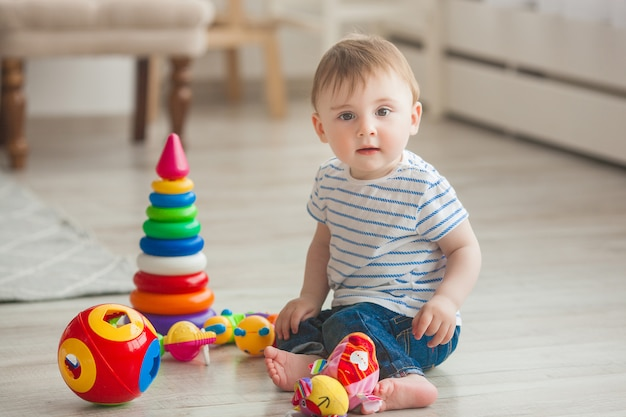Cute little child playing indoors. pretty infant baby boy
