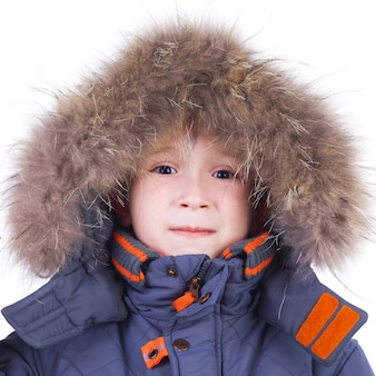 Cute little child in the winter fur clothing