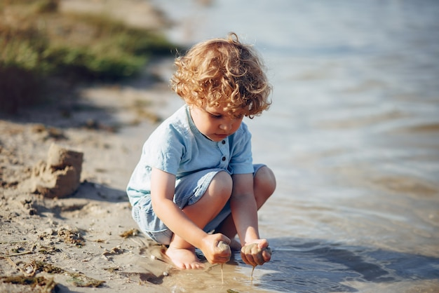 Cute little children playing on a sand
