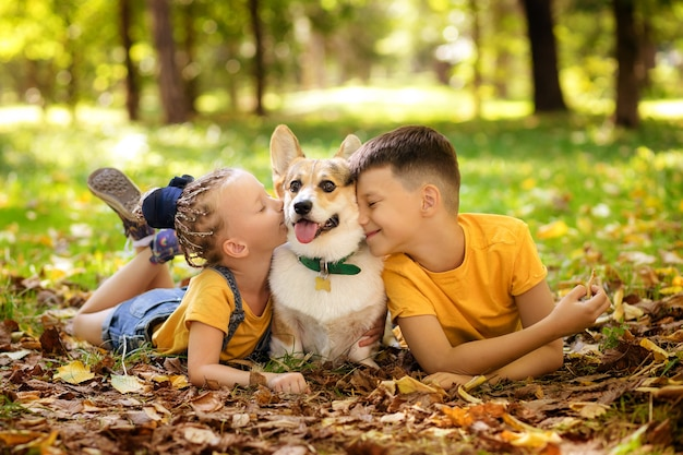 Cute little children with a dog in the park