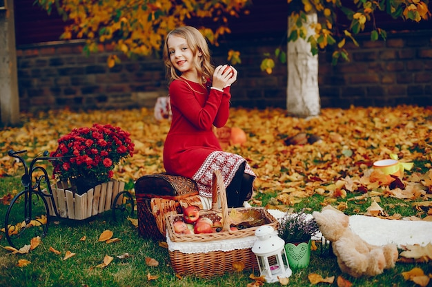 Cute little girl in a autumn park