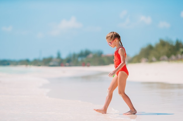 Cute little girl at beach during caribbean vacation