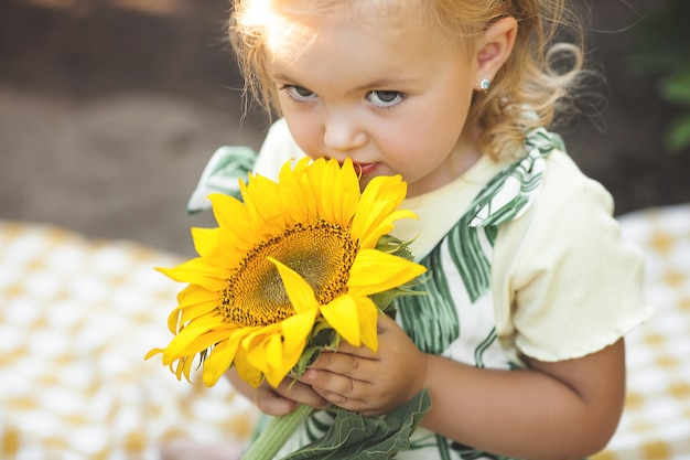 Cute little girl closeup portrait on summer background.