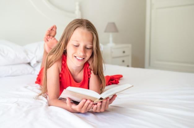 Cute little girl doing homework on laptop