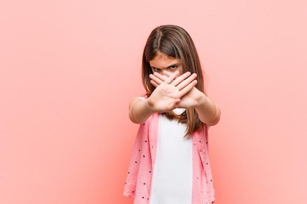 Cute little girl doingdenial gesture