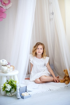 Cute little girl dreams of becoming a princess.