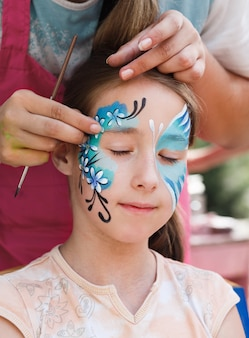 Cute little girl getting a face painting