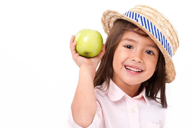 Cute little girl, hand holding green apple