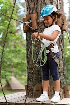 Cute little girl having fun at an adventure park