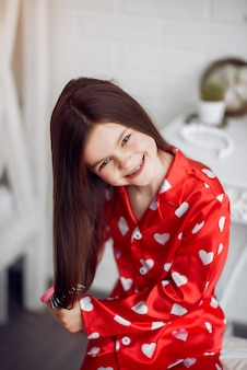 Cute little girl at home in a pajamas