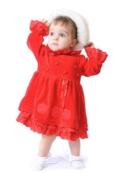 赤いドレスと帽子のかわいい女の子