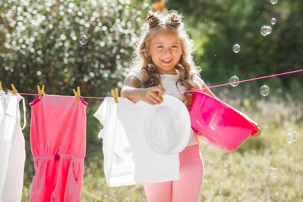 Cute little girl laundring
