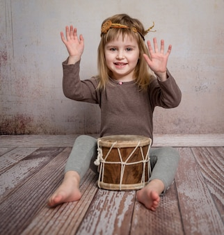 Cute little girl playing drum