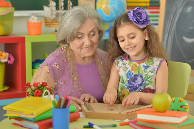 Cute little girl playing music  with granny